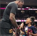 Kids on court with Cavs player JR Smith