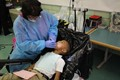 Mobile dentists give scholars in-school dental exams