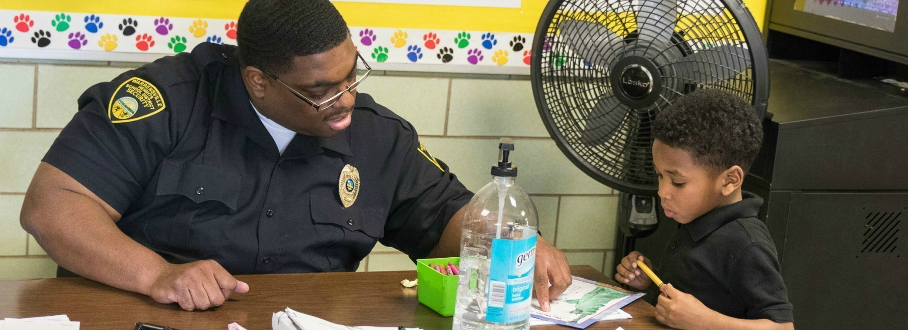 Security guard helping student with assignment