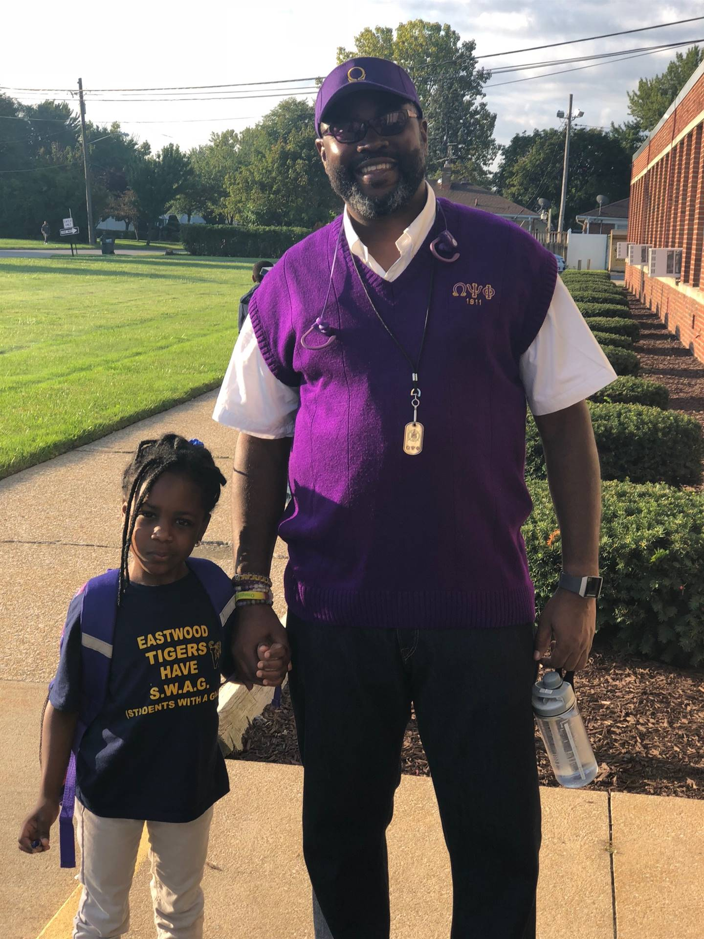 Mr. Roberts with Eastwood Scholar on Fathers Day Walk
